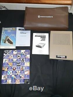 Commodore 64 Computer System Console withOriginal case, user manuals, modems -Used